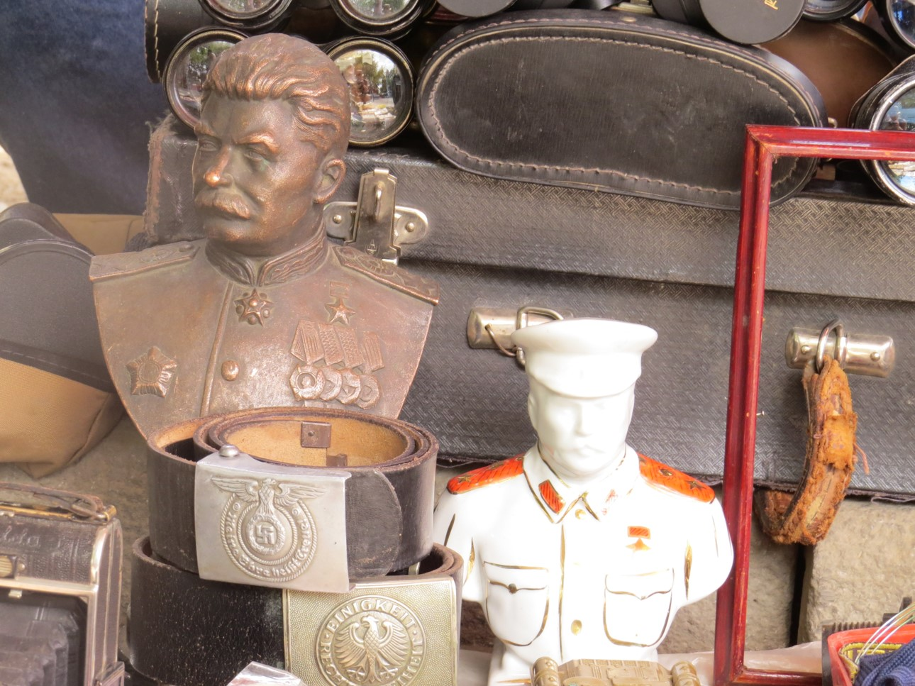 Miniature busts of Stalin covered with thick dust